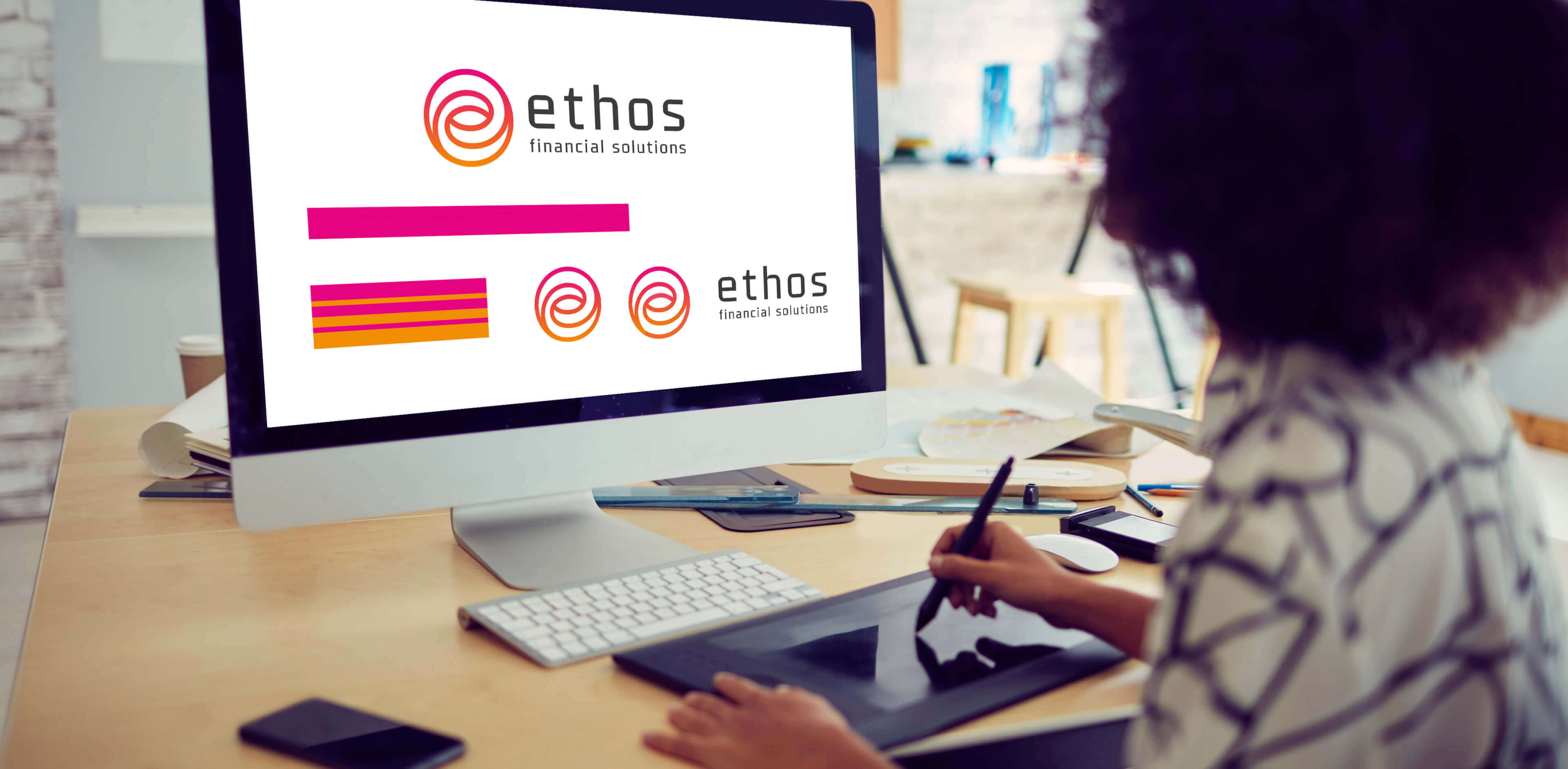 Ethos Logo design ideas on a laptop