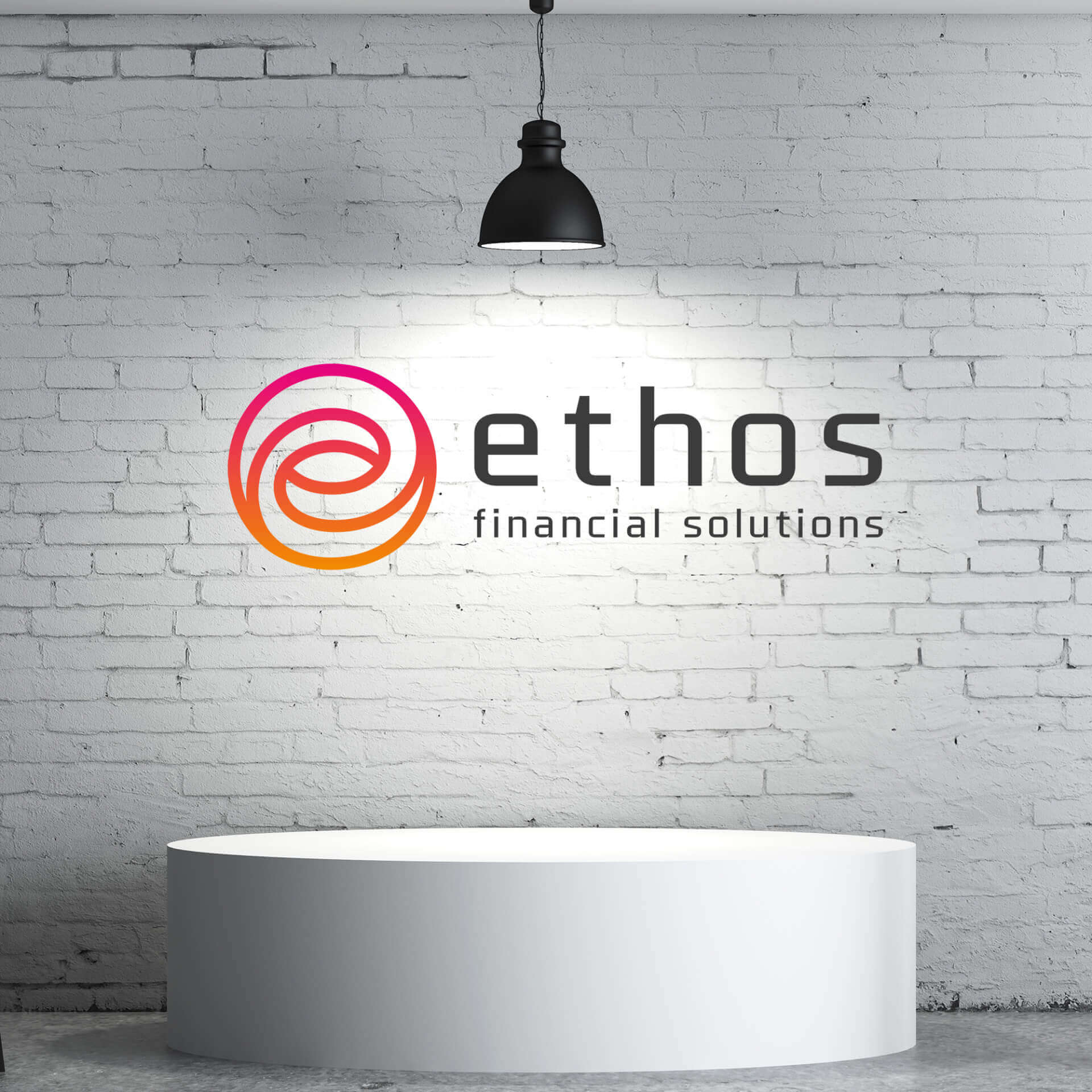 Ethos Logo printed on a wall