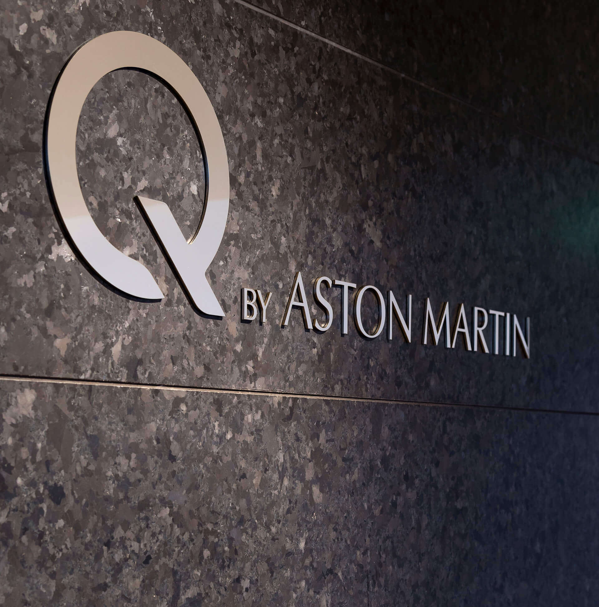 Q by Aston Martin Gold Wall Sign