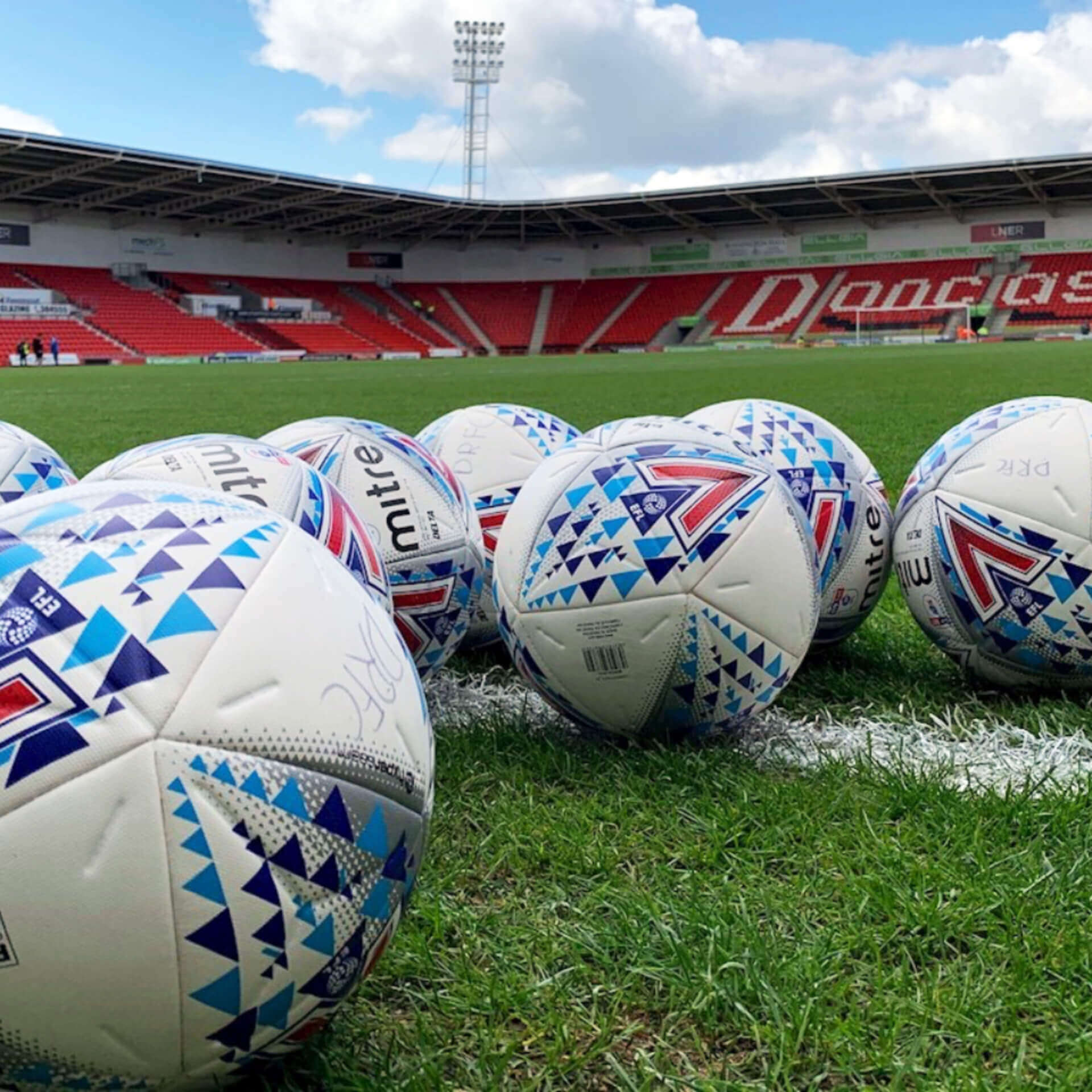 Footballs on the Doncaster Rovers Pitch